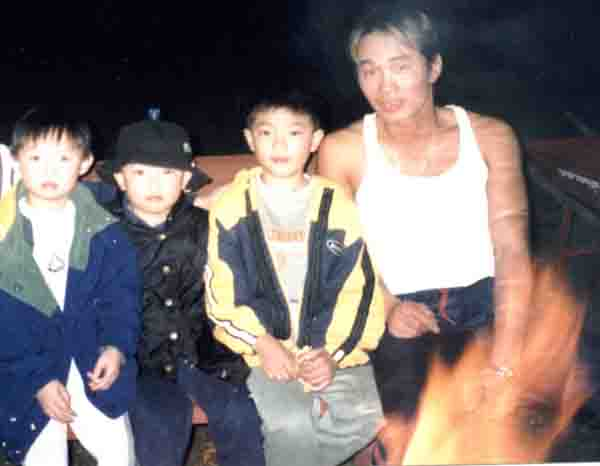 sitting beside the campfire with chris' kid and nephews, aren't they just adorable?