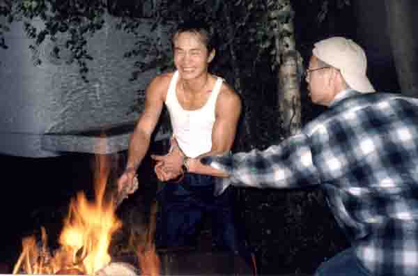 me and tony fooling around and having fun with the campfire